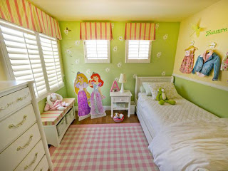 The pink accents add a soft femininity to the room, and they are all tied together by the pink checkered area rug.  Also, the butterflies that are so delicately placed around the room bring in a feeling of the outdoors. A great hand me down bed that was originally oak colored fills the room.